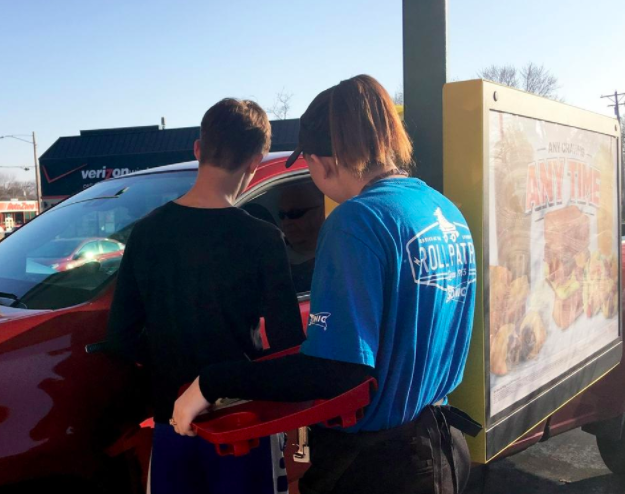 Frontenac Dollar Club members pay for Pittsburg Sonic Drive-in customers' meals on Saturday. The club does random acts of kindness throughout the year, this year they paid for 40 customer's meals at Sonic and gave a $120 tip to one of the servers. [STEPHANIE POTTER / THE MORNING SUN]